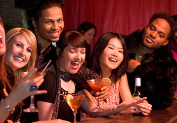 Large group of friends at bar in nightclub