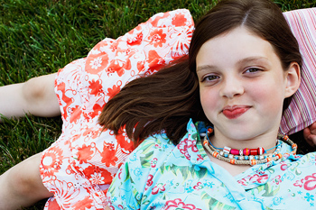 Girl relaxing on lawn