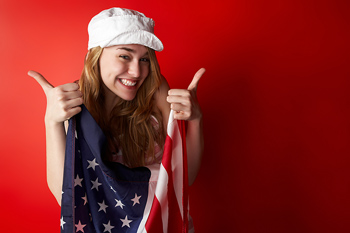 Studio shot of woman posing with American flag