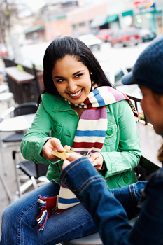 Woman giving credit card to boyfriend