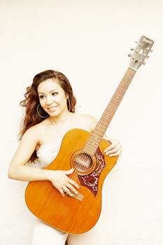 Woman posing with guitar