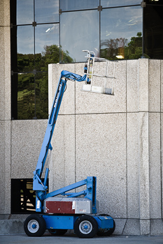 Cherry-picker by urban building