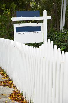Real estate services sign in yard in Miami, Florida