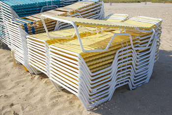 Stacks of lounges on beach in Miami, Florida