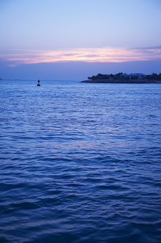Buoy and island in bay at sunset, Miami, Florida