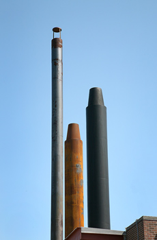 Industrial pipes against blue sky