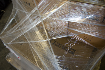 Boxes bundled with shrink wrap and cord