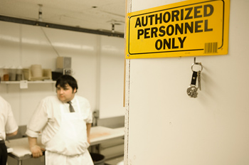 Authorized personnel only sign on door of kitchen in butcher shop