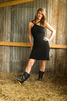 Sexy woman in dress posing in barn