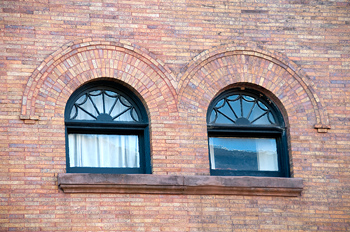 Architectural detail of windows in brick building