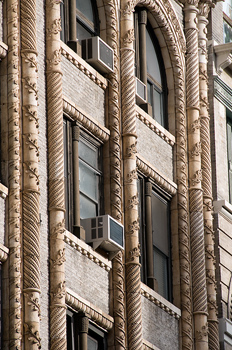 Ornate architecture with twisted columns on building in New York City, USA