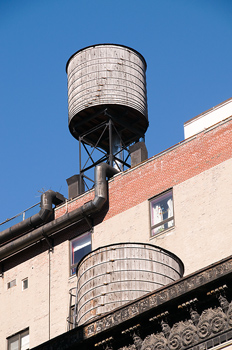 Water towers on roof of building in New York City, USA