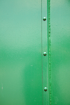 Glossy surface of metal painted green