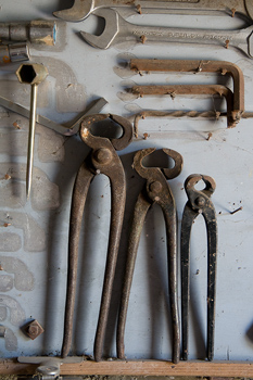 Wrenches and wire cutters on wall