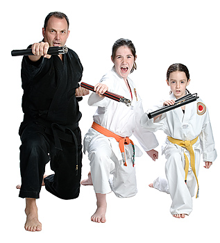 Martial arts instructor posing with girl students
