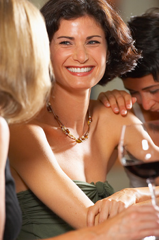 Smiling woman at bar with friends