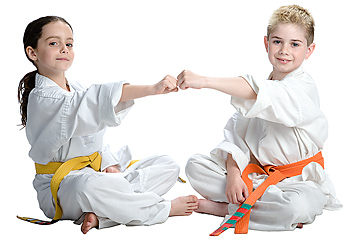 Boy and girl martial arts students doing knuckle bump