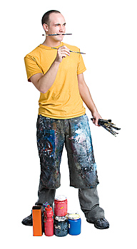 Man holding paint brushes in hands and mouth