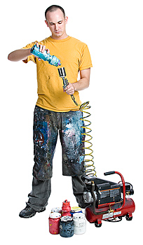 Man attaching bottle to paint sprayer and air compressor