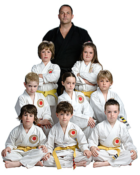 Group portrait of martial arts students and instructor