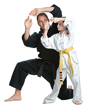 Martial arts instructor teaching girl student